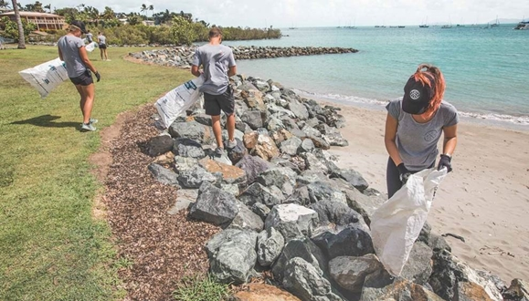 Image forMY Dragonfly crew help with Whitsunday beach clean up